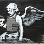 Cherub with a bullet proof vest, Banksy